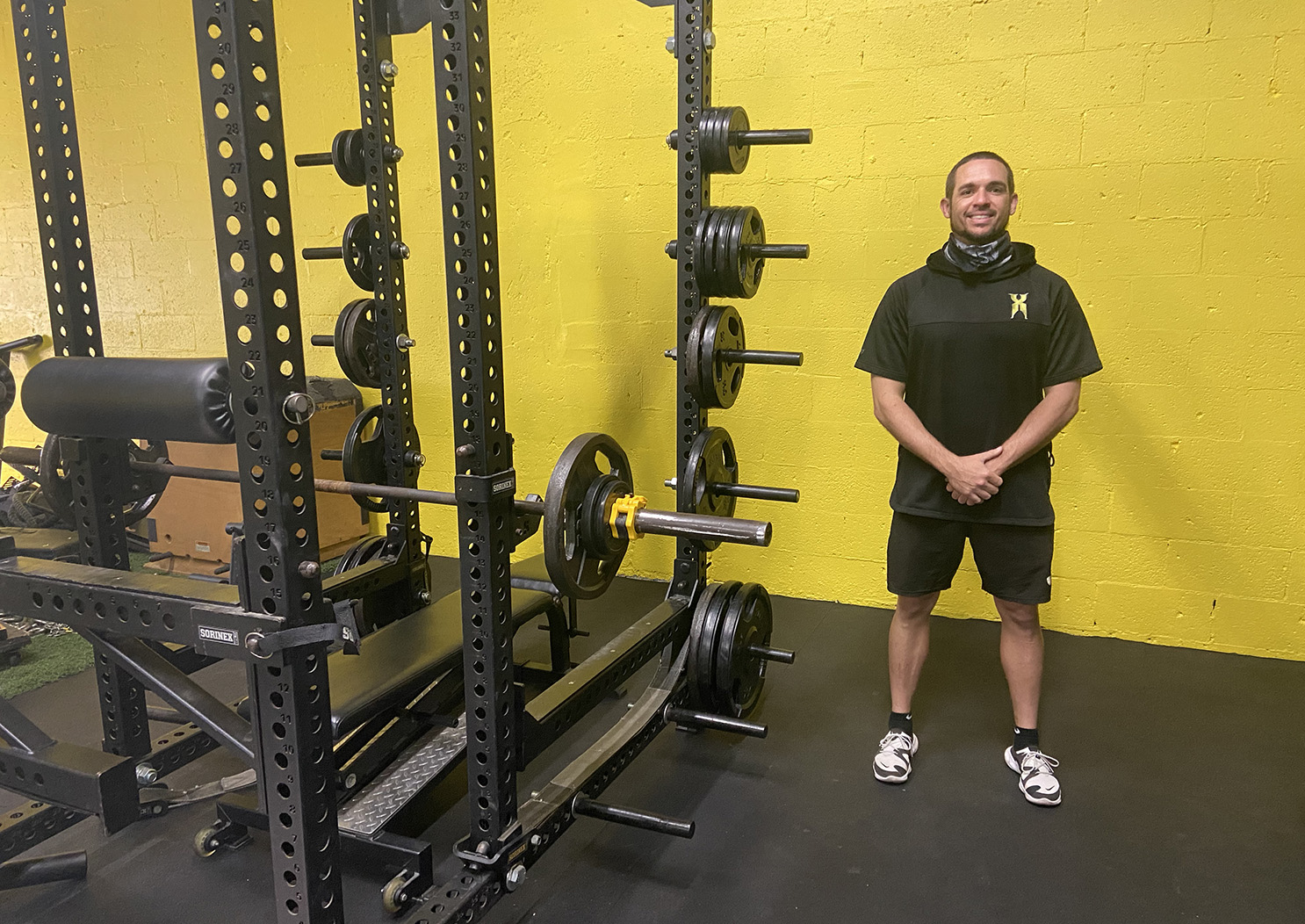 Daniel Marks standing next to gym equipment.