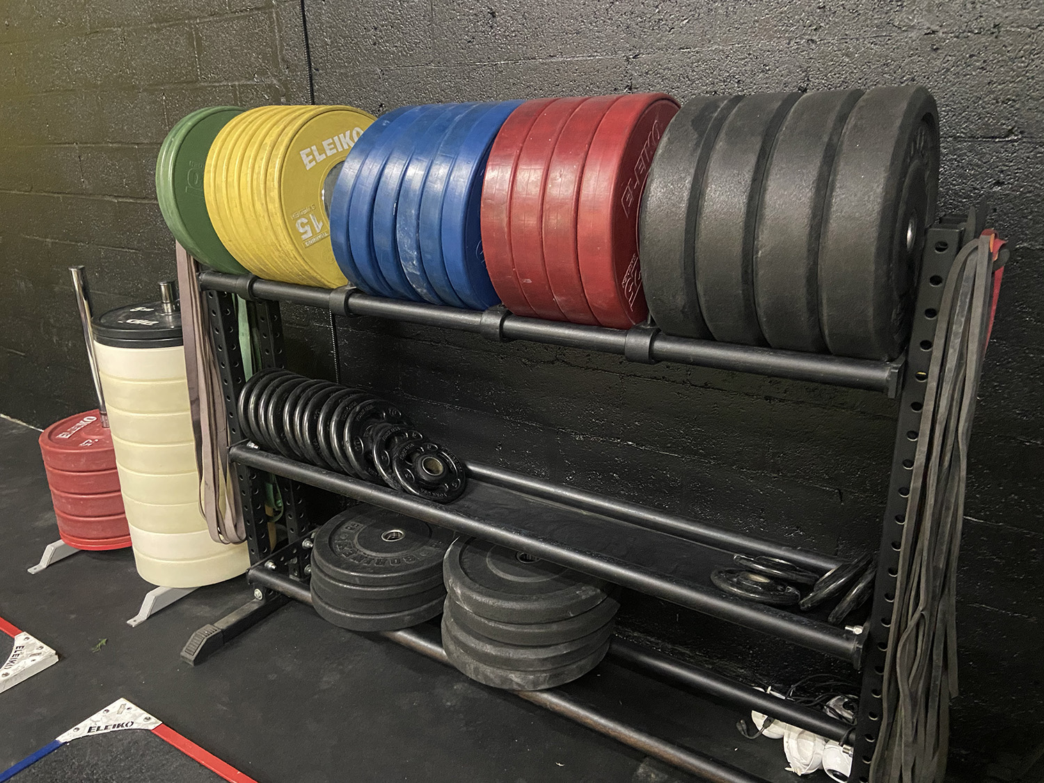 Weighted plates on a rack at a gym